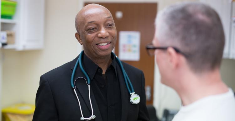 doctor speaking to patient