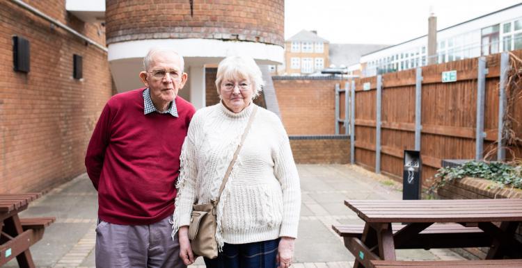 elderly couple stood together