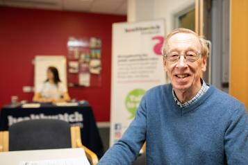 Man at a Healthwatch meeting looking at the camera