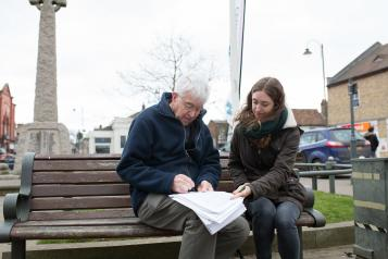 two people sat on bench at healthwatch event