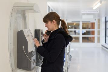 person using telephone in hospital