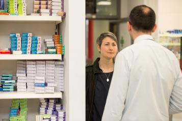 woman speaking to pharmacist