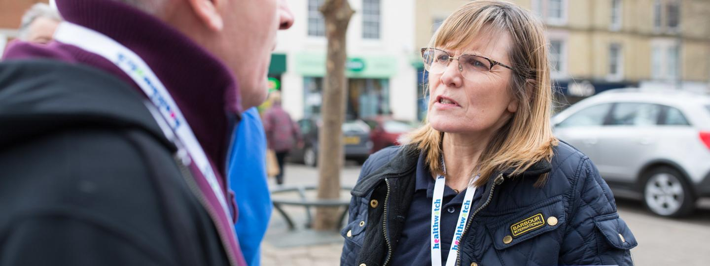 Healthwatch staff member talking to a member of the public about their experience